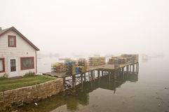 Maine fishing wharf in fog. A view of a fishing wharf on Bass Harbor in dense, coastal Maine fog Stock Photography