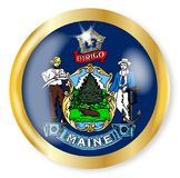 Maine Flag Button. Maine state flag button with a gold metal circular border over a white background Stock Photos