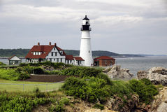 Maine Light House. A light house on the cliffs in portland maine stock photo