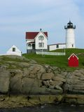 Maine Lighthouse. A white lighthouse stands on the rugged shoreline of Maine Royalty Free Stock Photo