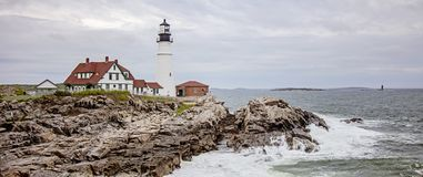 Maine lighthouse Portland Head Light. Panorama of Portland Head Light, Lighthouse in Portland Maine USA Cape Elizabeth on a cloudy spring day. Maine`s oldest royalty free stock photography