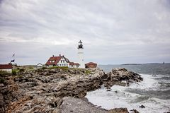 Maine lighthouse Portland Head Light. Portland Head Light, Lighthouse in Portland Maine USA Cape Elizabeth on a cloudy spring day. Maine`s oldest operating royalty free stock photo