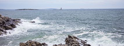 Maine ram island ledge light station. Panorama of Ram island ledge light station in Portland Maine USA from Cape Elizabeth on a cloudy spring day, marking the royalty free stock photos