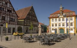 Maine square in Bad Bruckenau Germany. Surrounded with old half-timbered house and a blue sky in background Royalty Free Stock Photo