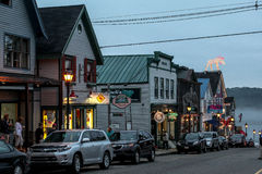 Maine Street in Bar Harbor with tourists and evening lights Stock Photos