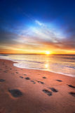 Maine summer sunrise. Maine beach as sun comes over the horizon Royalty Free Stock Images