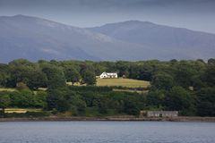The mainland of Wales. The mainland of North Wales, United Kingdom, on a hot summer`s day viewed from the Menai Straits stock photo