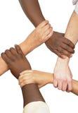 Mains étreintes dans l'unité Photos libres de droits