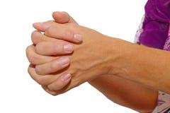 Mains étreintes dans la prière Photographie stock libre de droits