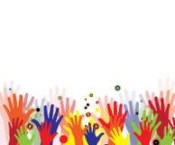 Mains abstraites d'enfants en peinture colorée Images libres de droits