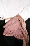 Mains attachées sur l'affaire image libre de droits