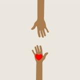 Mains atteignant dans l'amour Photographie stock libre de droits