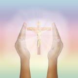 Mains augmentées par prière pour Jesus Christ rougeoyant Image stock
