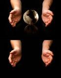 Mains autour de globe Photographie stock