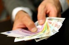 Mains avec de l'argent Image libre de droits