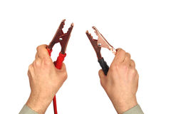 Mains avec des câbles de pullover sur le blanc Photographie stock