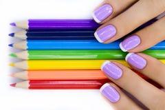Mains avec des crayons Photographie stock libre de droits