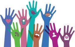 Mains avec des icônes de communication. Image stock