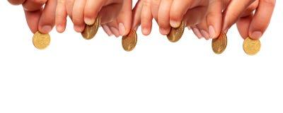 Mains avec des pièces de monnaie. Photo libre de droits