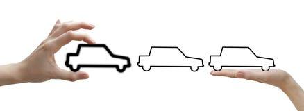 Mains avec des véhicules de noir de concept Images stock