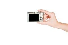 Mains avec l'appareil photo numérique Image libre de droits
