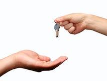Mains avec la clé Photo libre de droits