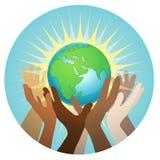 Mains avec la terre Photos libres de droits