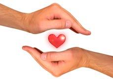Mains avec le coeur Photographie stock