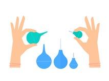 Mains avec le lavement en caoutchouc Médical, clinique, équipement d'hôpital, C.A. Photographie stock libre de droits