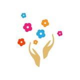 Mains avec le logo de fleurs Image libre de droits