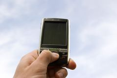 Mains avec le smartphone Image libre de droits