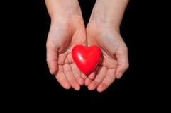 Mains avec un coeur Photos stock