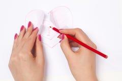 Mains, coeur coupé et espoir à l'intérieur Photo stock