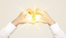 Mains créant une forme avec le symbole dollar Images stock