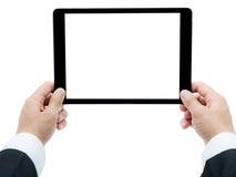 Mains d'homme d'affaires jugeant le comprimé d'isolement Photographie stock libre de droits