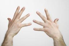 Mains d'homme d'isolement Image libre de droits