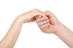 Mains d'homme et de femme d'isolement sur le blanc Images stock