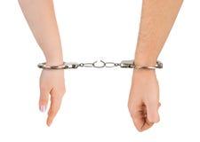 Mains d'homme et de femme et menottes de rupture Photos stock
