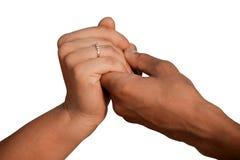 Mains d'un homme et d'une femme sur un isolant blanc de fond Images stock
