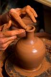Mains d'un potte Image stock