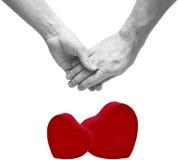 Mains d'une exploitation de couples de jeunes Image stock