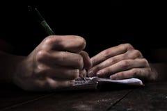 Mains dans l'obscurité Photos libres de droits