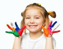 Mains dans la peinture Photos libres de droits