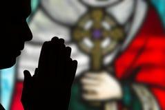 Mains dans la prière Photographie stock libre de droits