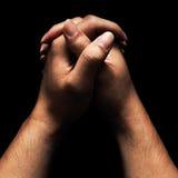 Mains dans la prière photographie stock