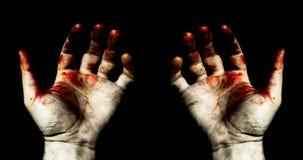Mains dans le sang Photographie stock