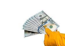 Mains dans les gants avec des billets de banque image stock