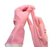 Mains dans les gants en caoutchouc Image stock