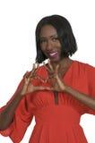 Mains de coeur de femme Photo stock