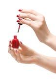 Mains de femme avec la peinture rouge Photographie stock libre de droits